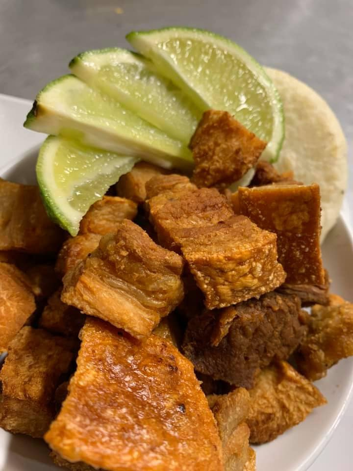 fried pork belly with lime wedges