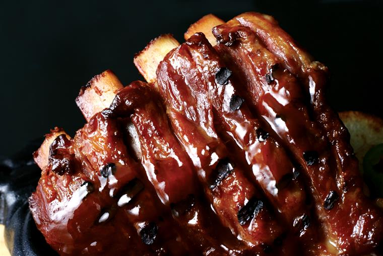 Ribs covered in BBQ sauce