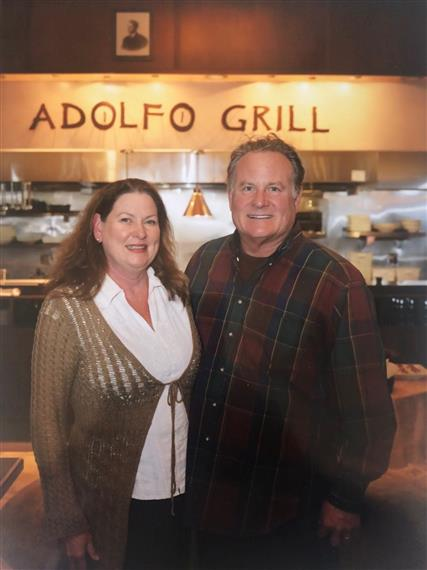 tori and tom dann, owners, standing inside adolfo grill