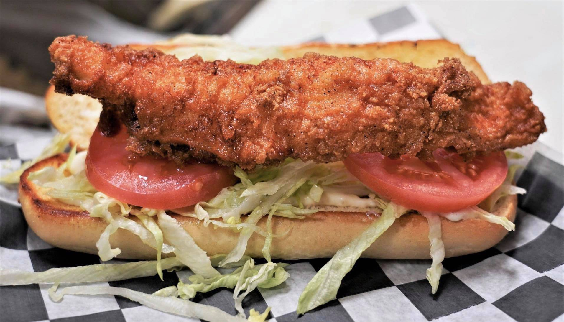 fried catfish sandwich with lettuce and tomatoes