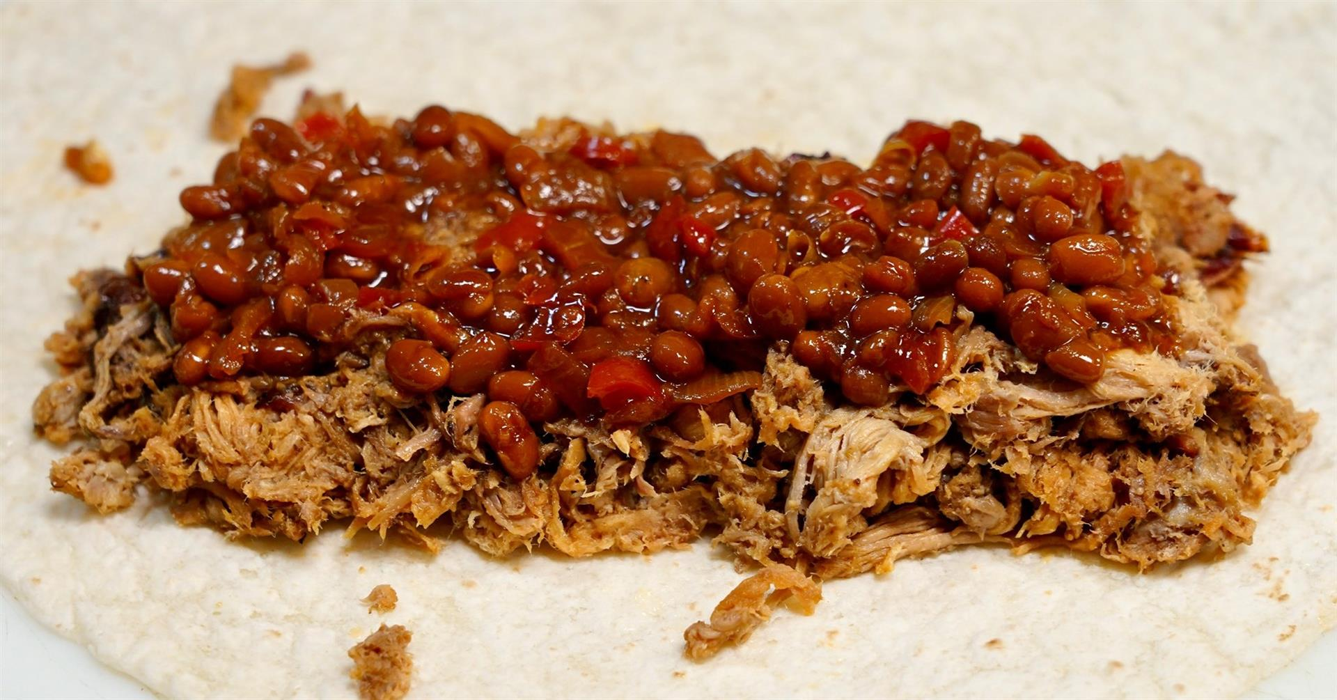 pulled pork topped with chili and beans