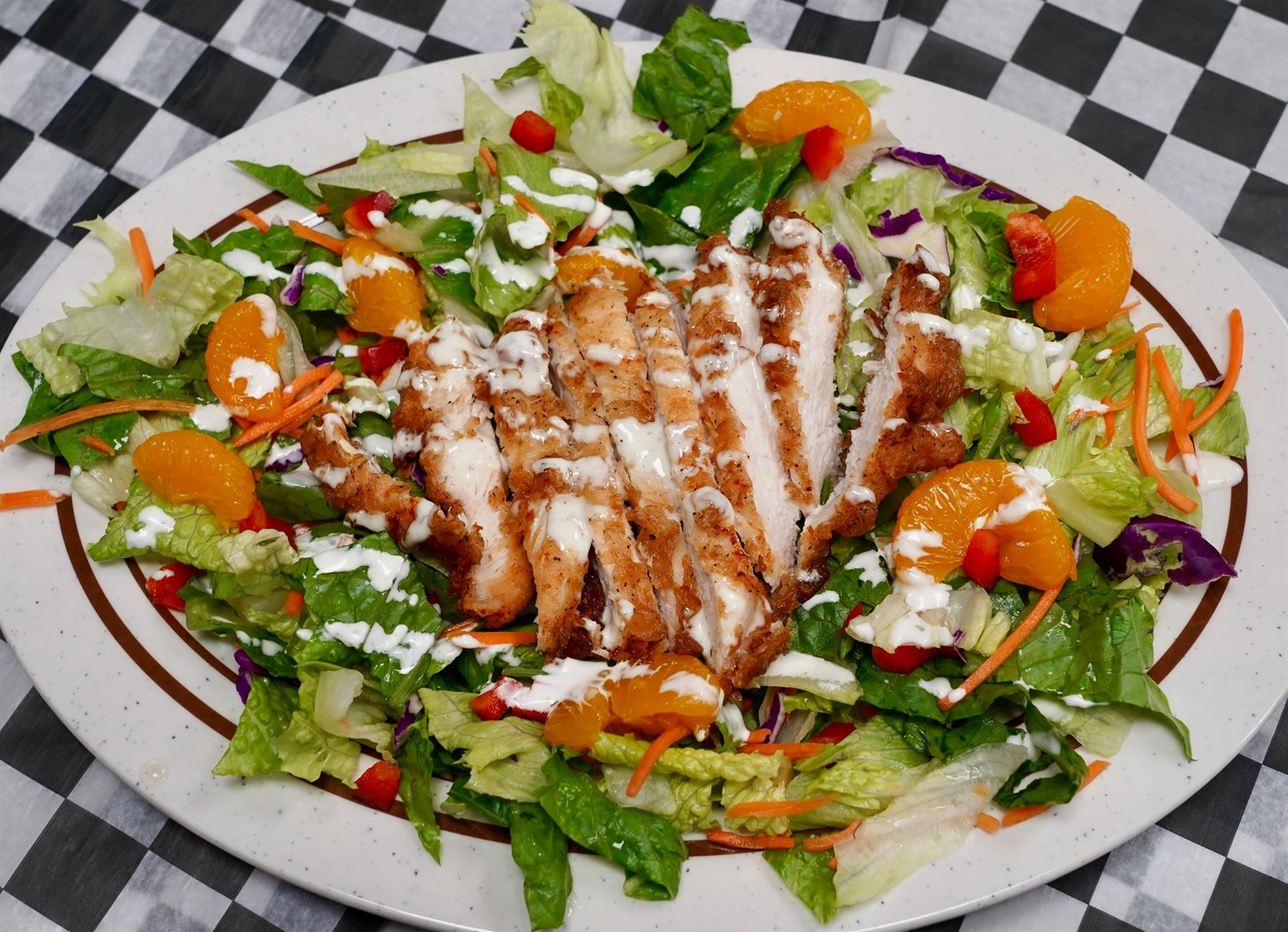 crispy chicken salad with lettuce, carrots, and mandorin oranges
