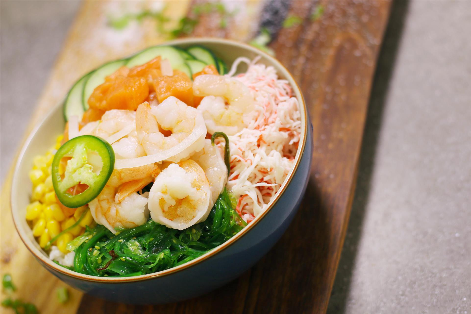 poke bowl with various ingredients, including shrimp