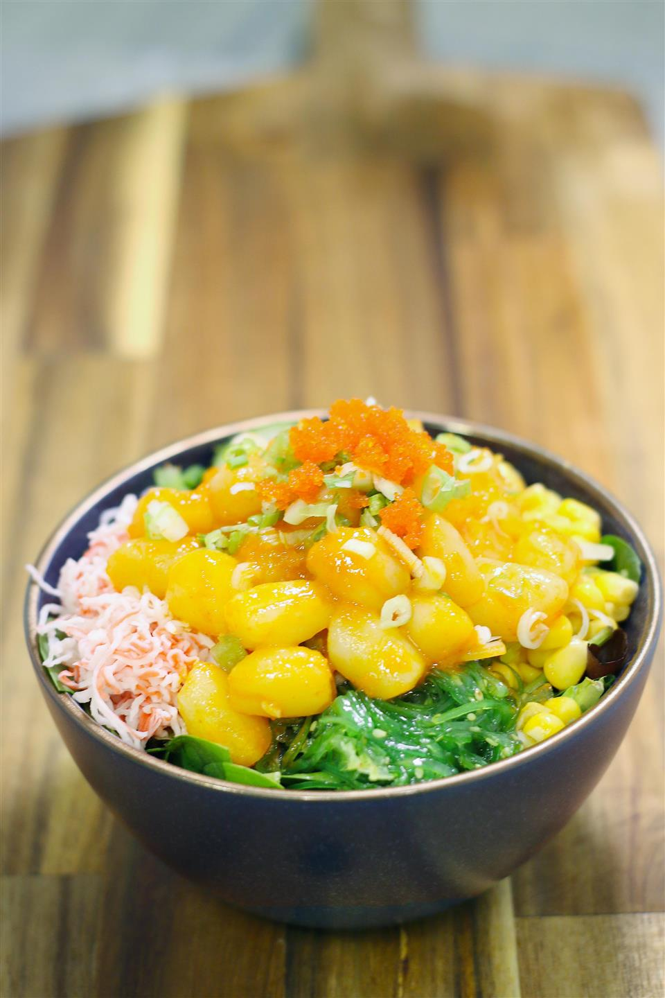 poke bowl with crab meat, carrots, seaweed and mango