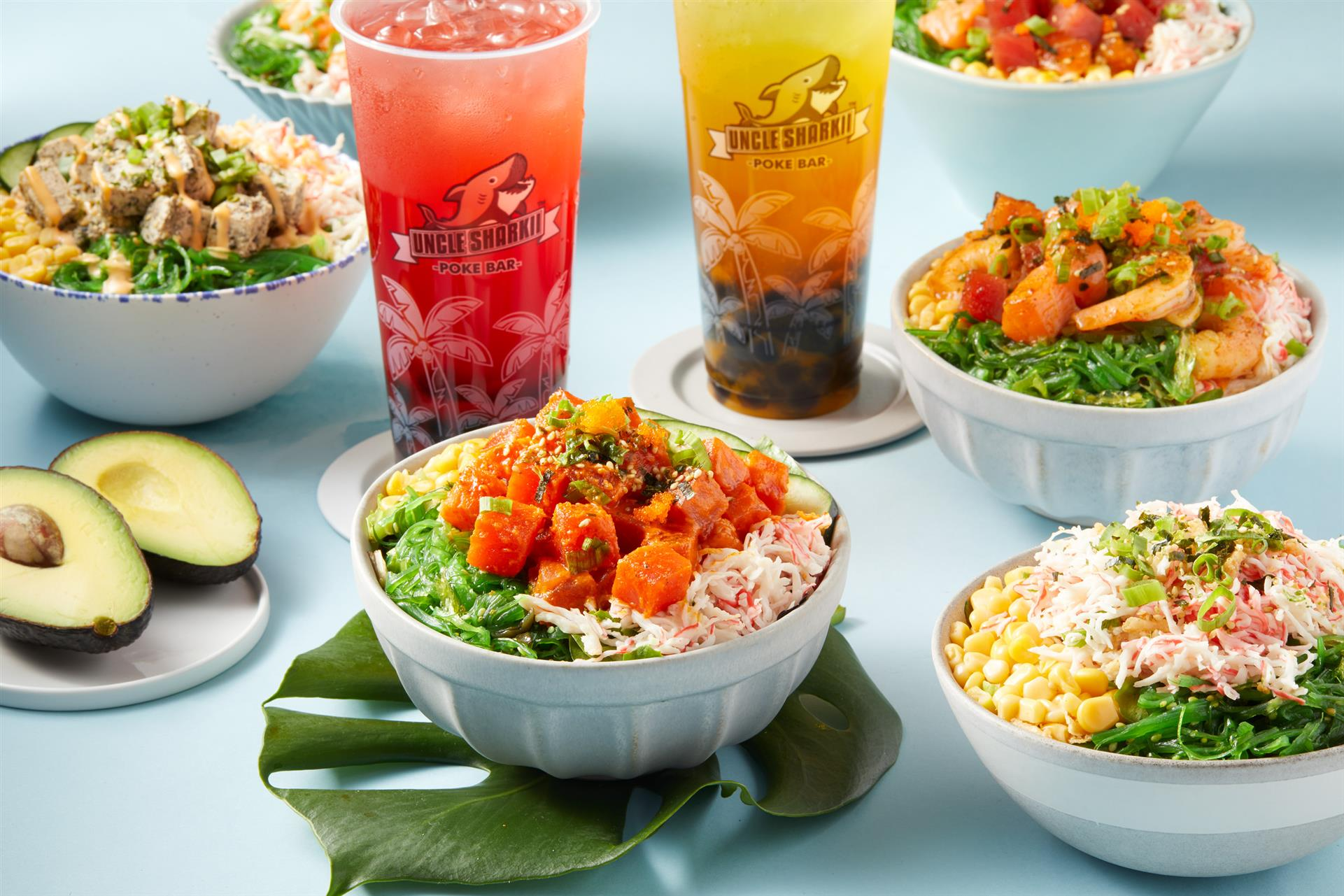 several different poke bowls and drinks