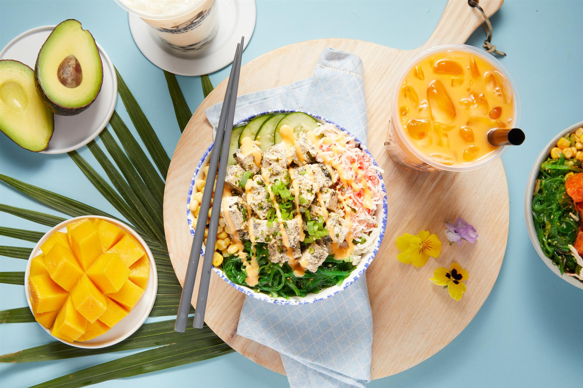 poke bowl with a side of mango and a smoothie