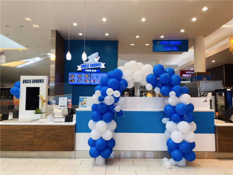 Uncle sharkii's fairfield location. Balloon arch in front of counter