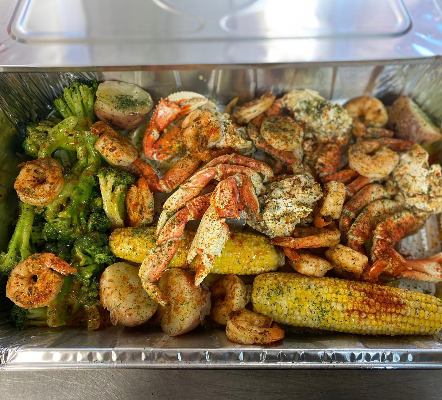 UPTOWN OCEAN PRIME Platter: Two Dungeness Clusters, Five Colossal Shrimp, Corn on The Cob and Broccoli