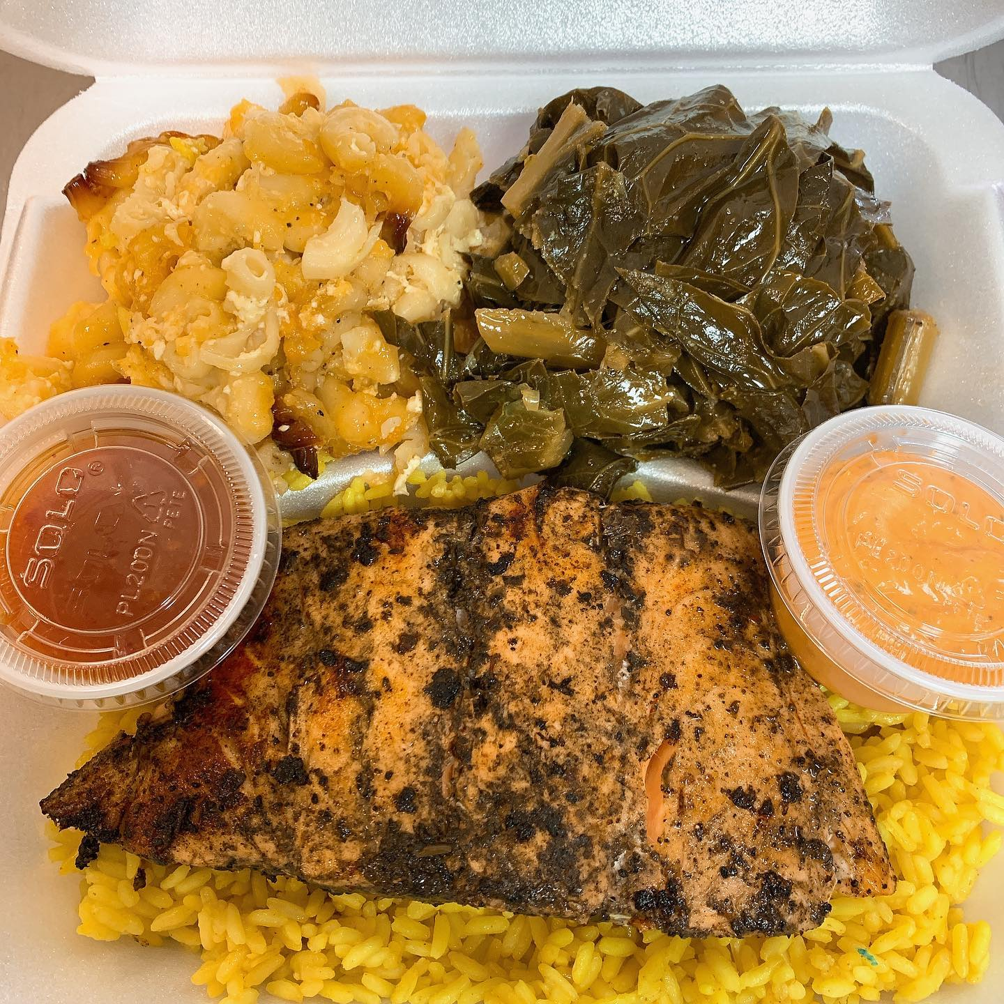 blackened chicken over rice with mac salad and collard greens