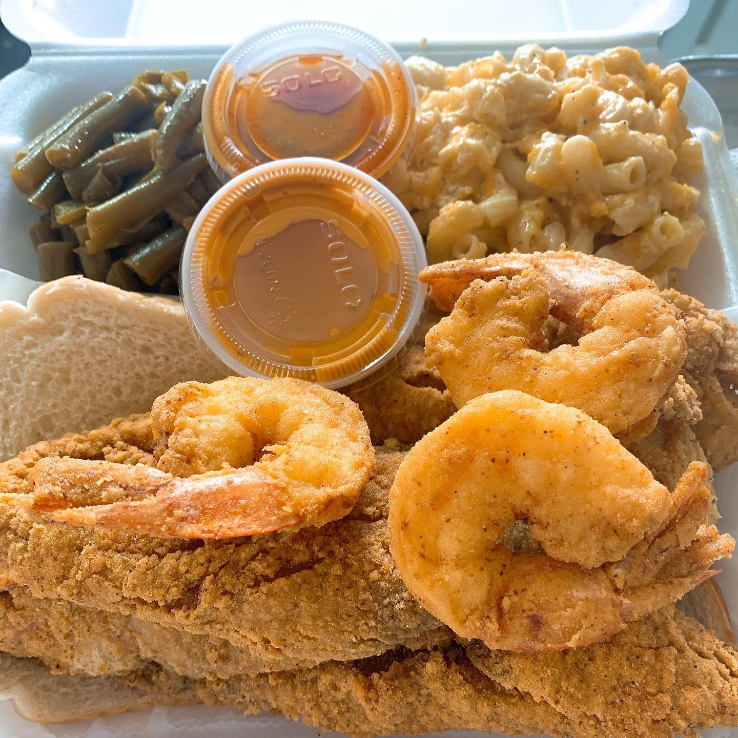 fried fish platter with fried shrimp, mac salad and collard greens