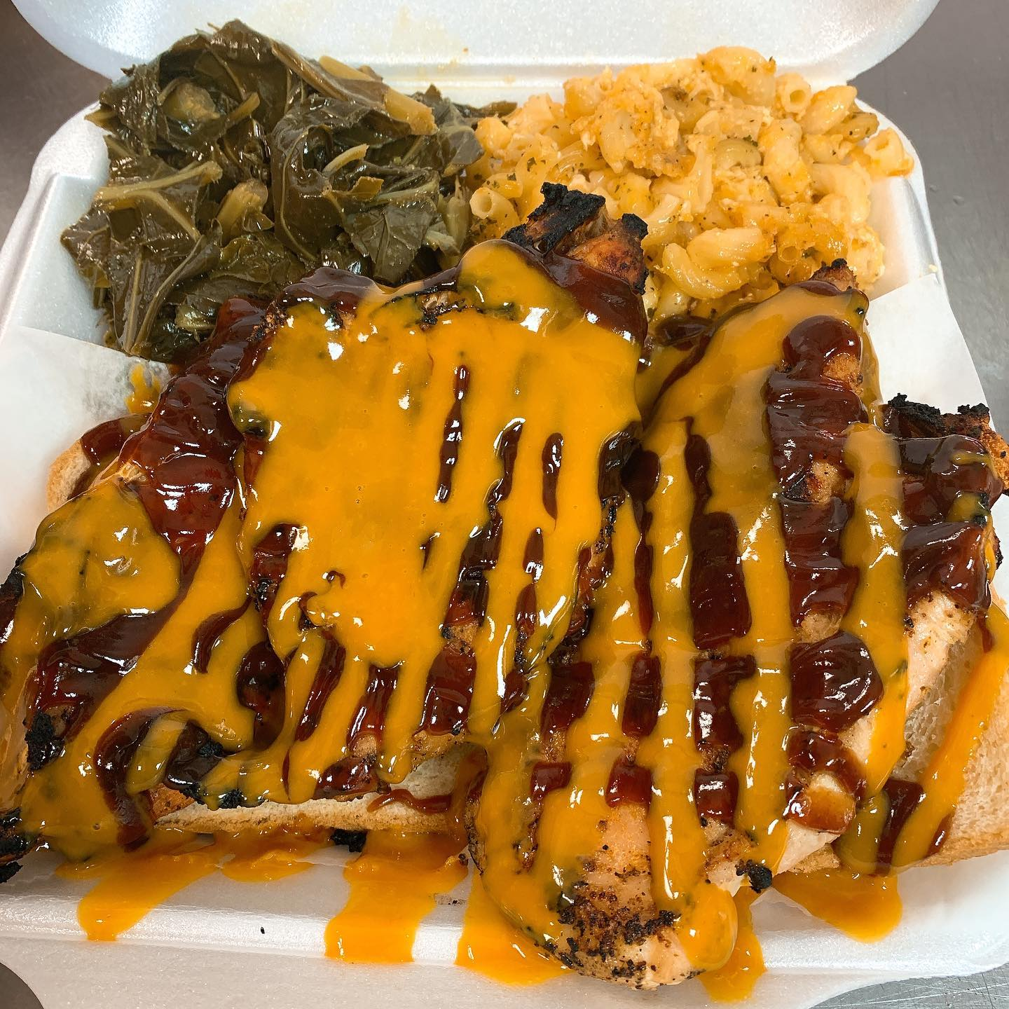 jerk chicken platter with mac salad and collard greens