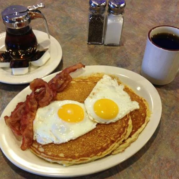 pancakes with eggs and bacon, with maple syrup and coffee on the side