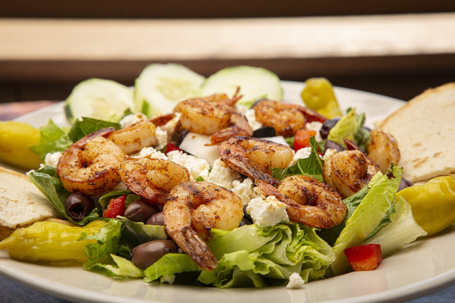 salad topped with grilled shrimp