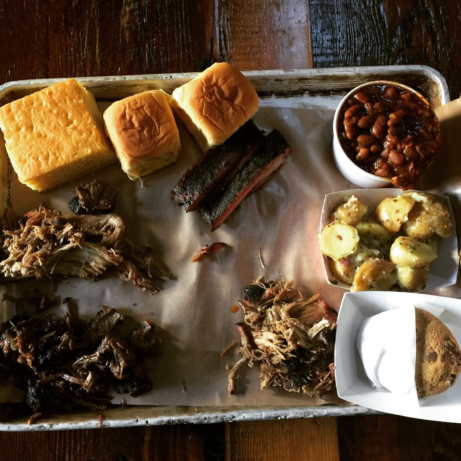 plate of barbecue meats and corn bread
