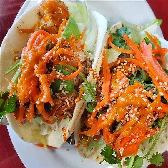 asian tacos with shredded carrots and sesame seeds