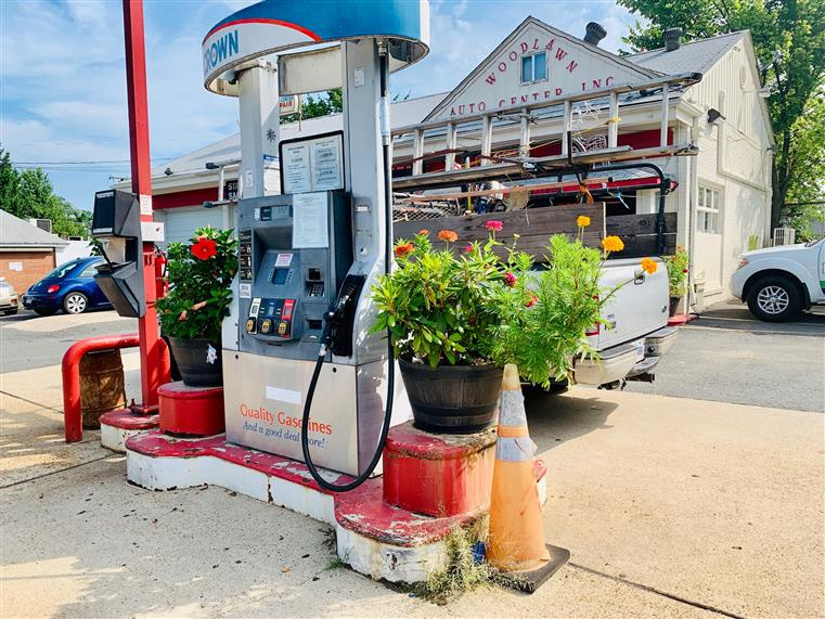 front of auto repair shop with gas pump service