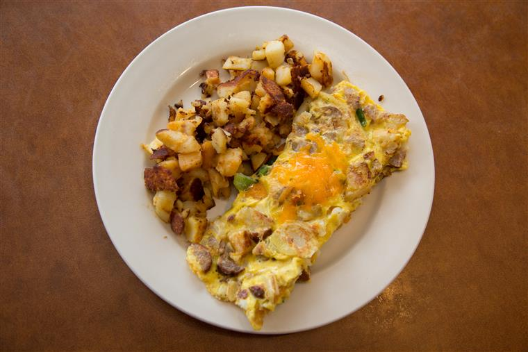 omelette on a plate with breakfast potatoes
