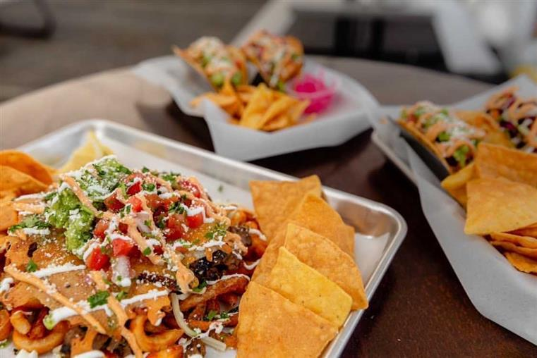 assorted plates of loaded nachos