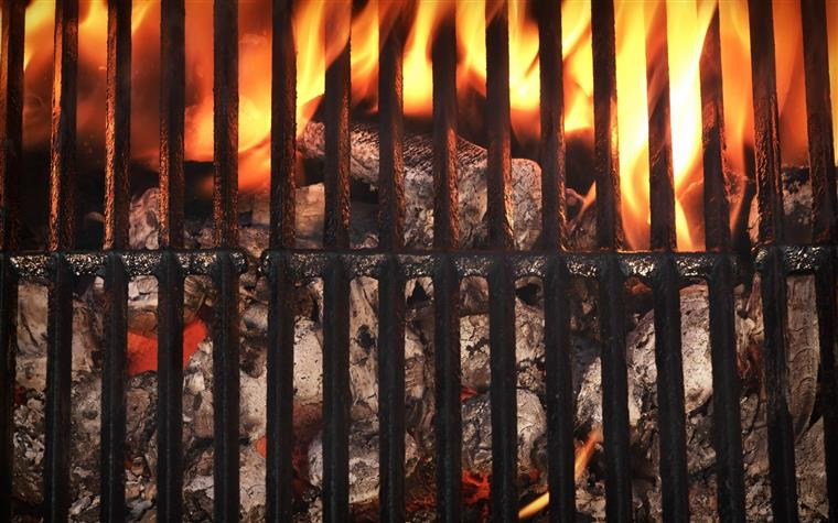 close-up of a charcoal flame grill