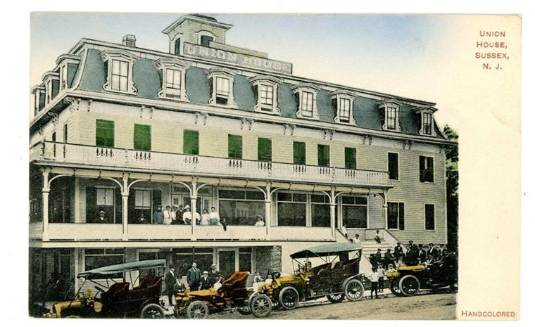 exterior shot of the building with old cars in front