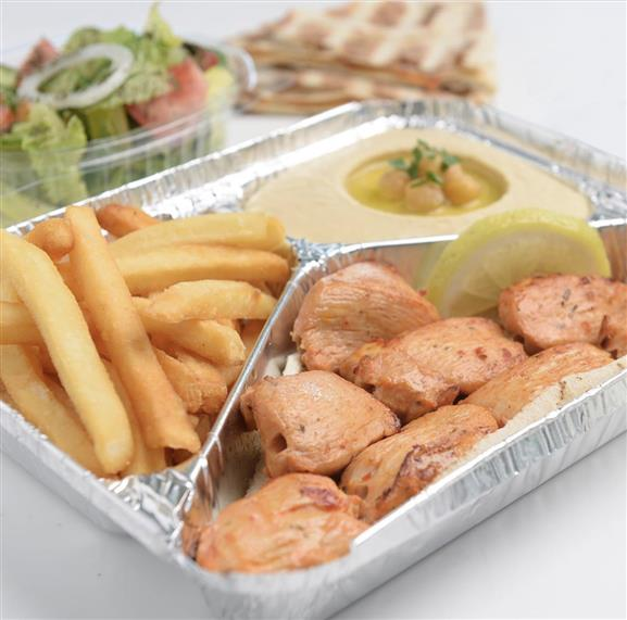 Chicken Kabab:  Marinated charcoal-grilled chicken with garlic sauce. Served with french fries and hummus