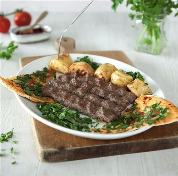 Arayess: Mix of lamb and beef meat with parsley, onion and mixed spices stuffed in pita bread and grilled on charcoal