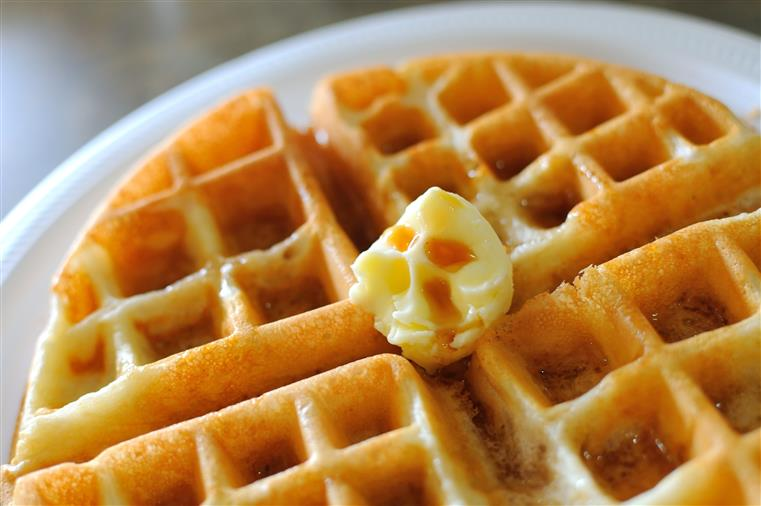 waffle topped with butter and syrup