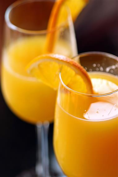 two mimosas with orange slices