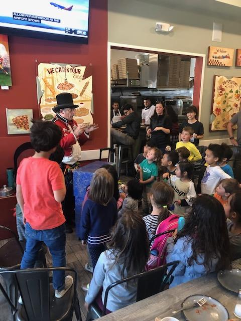group of children watching a magic show