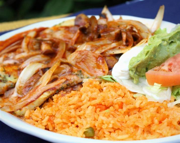 El Volcano Dinner: Grilled chicken breast topped with mushrooms, onions and cheese dip with our homemade Mexican mild sauce. Served with Spanish rice, shredded lettuce, sour cream, guacamole and your choice of corn or flour tortillas