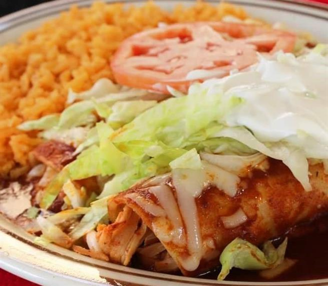 Enchiladas Supreme: A supreme combinations of enchiladas: 1 chicken, 1 beef, 1 bean and 1 cheese. Topped with La Tolteca cheese, lettuce, tomatoes and sour cream