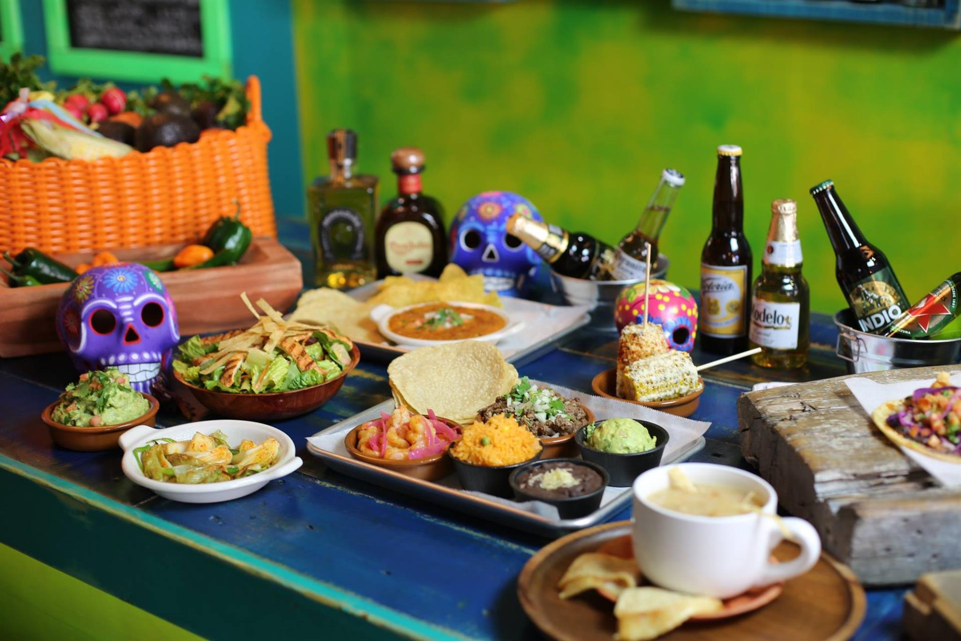 assortment of food and alcoholic drinks on a table