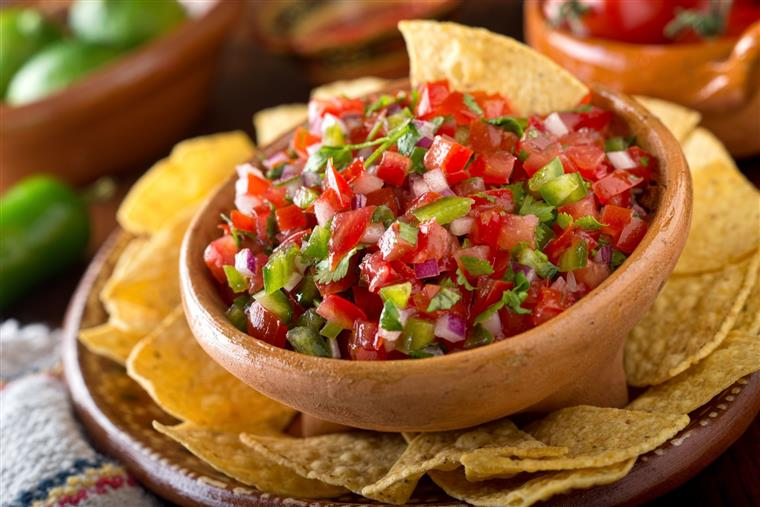 bowl of salsa with a side of tortilla chips