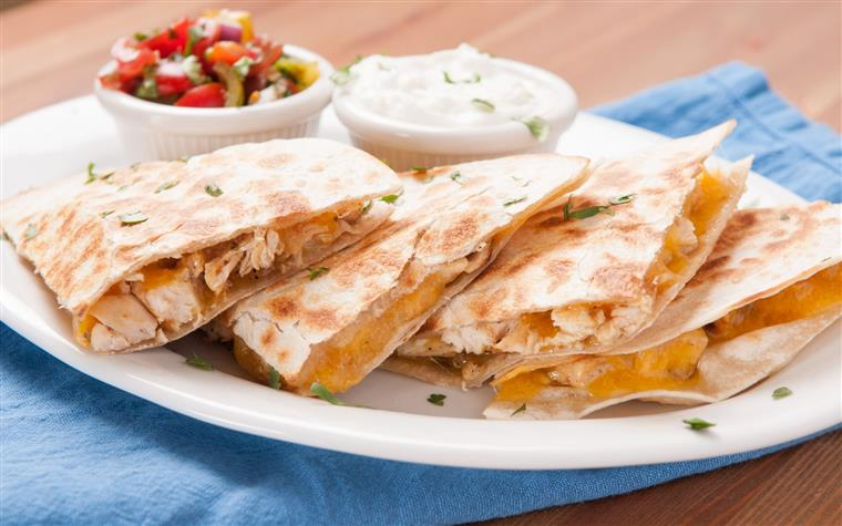 chicken and cheese quesadilla with a side of salsa and sour cream