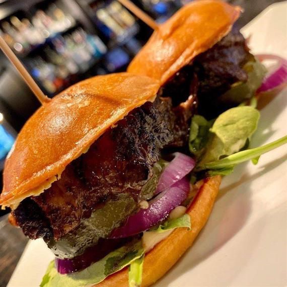 steak sliders with onions, lettuce, pickles and mayo
