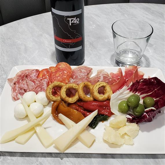 charcuterie plate with t42 label chianti