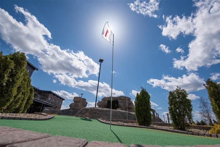 Image of part of a miniature golf course on a sunny day