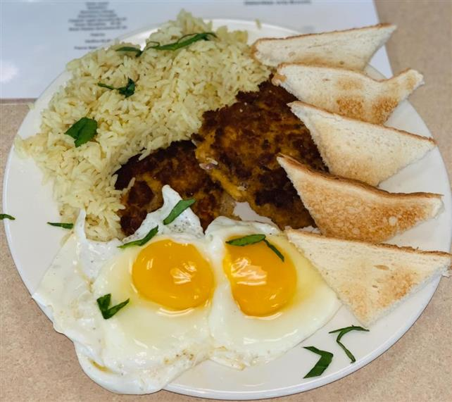 plate of sunny-side up eggs with toast, sausage, and hash browns