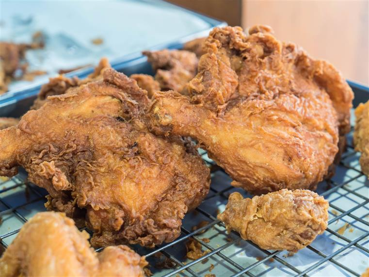 fried chicken on a cooling rack