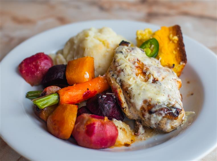 Southern Grilled Chicken: half pound, all natural marinated chicken breast-grilled and basted with our own Memphis style peppercorn, parm ranch dressing, served with mashed potato, slaw and jalapeno cornbread