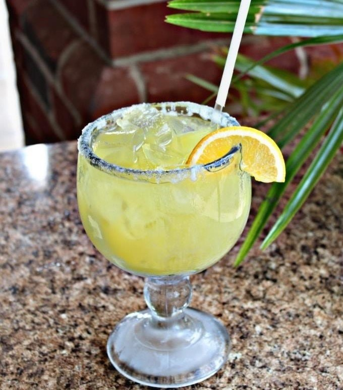 margarita with a lemon wedge and straw