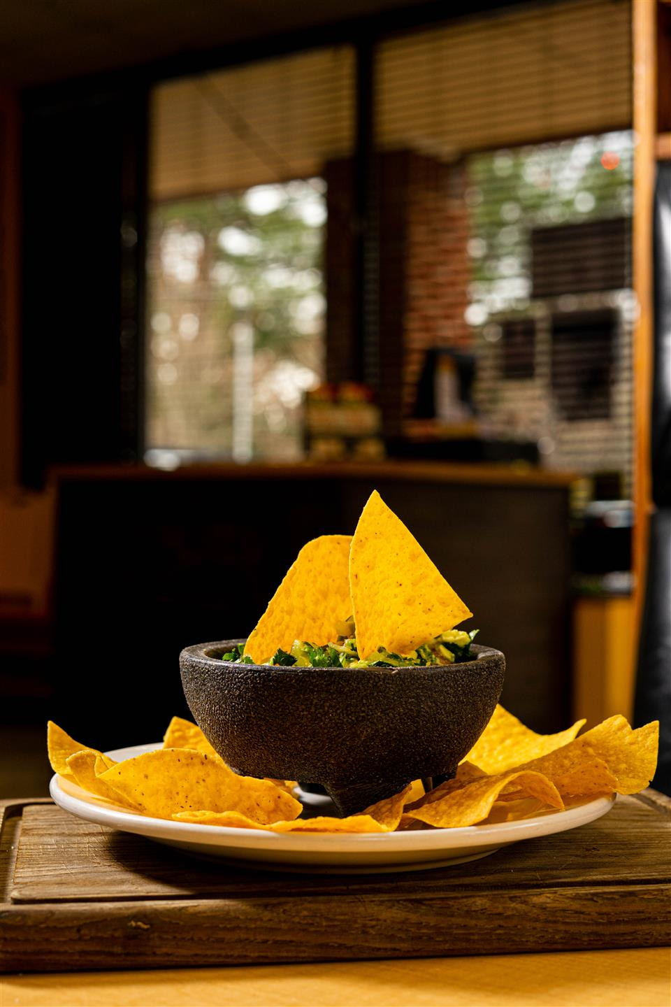 bowl of fresh guacamole with tortilla chips