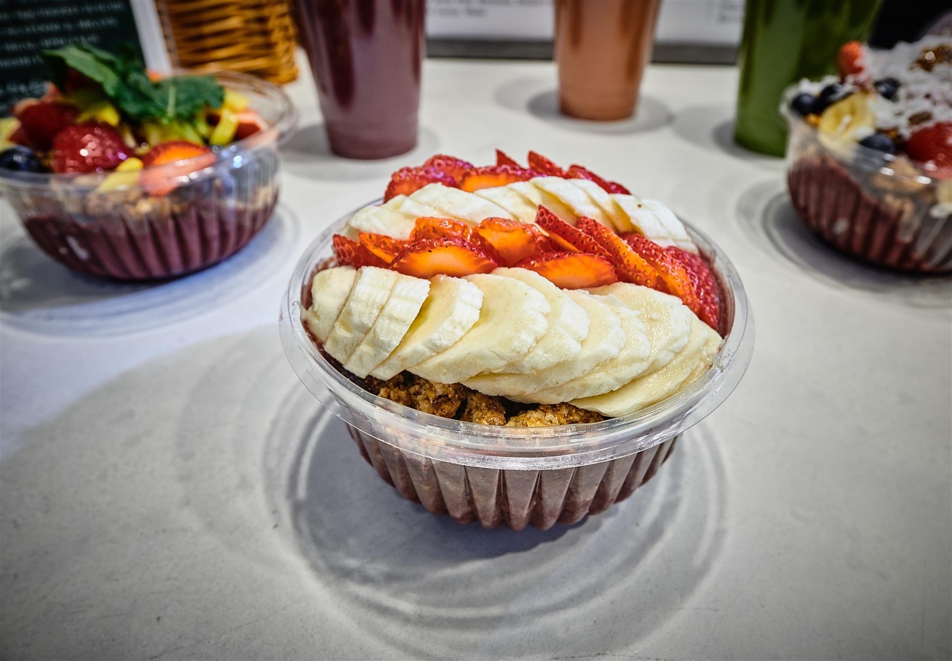 acai bowl topped with strawberries and bananas