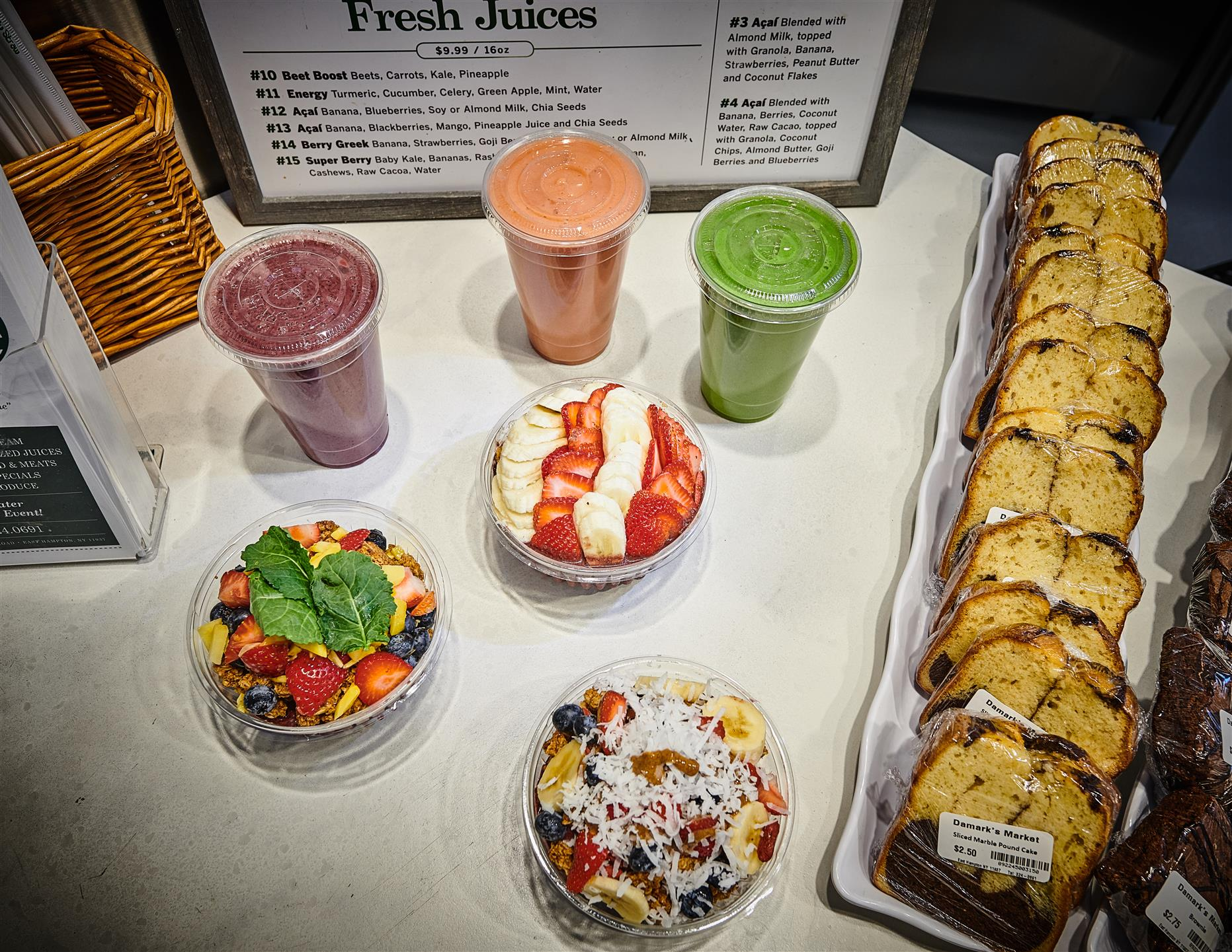 assortment of acai bowls and smoothies with an assortment of marble cake