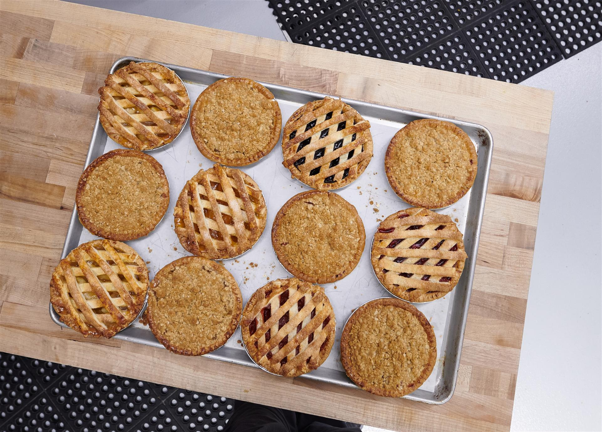 assortment of baked pies on a tray
