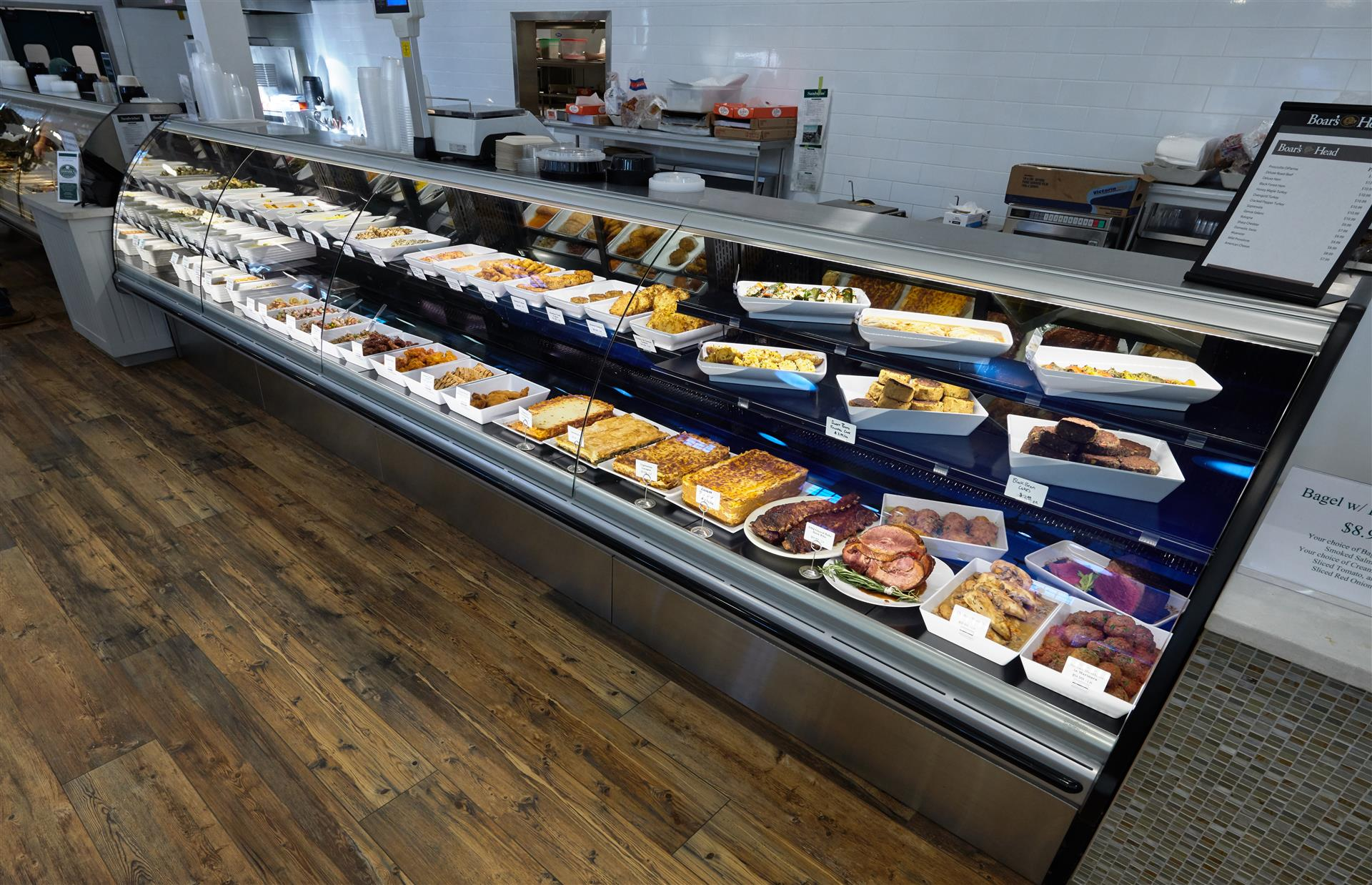 display case of meats and precooked food