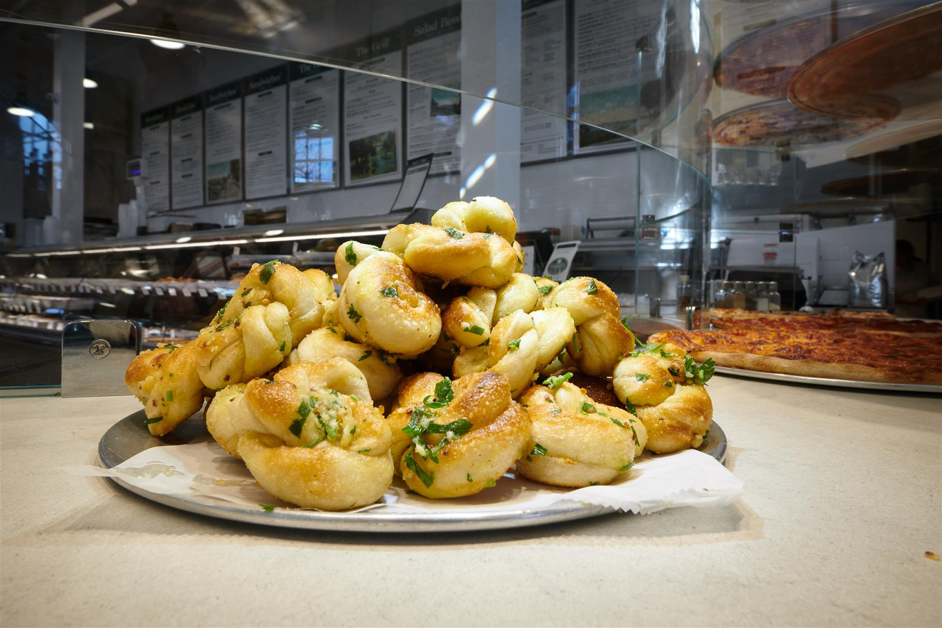 plate of garlic knots piled up