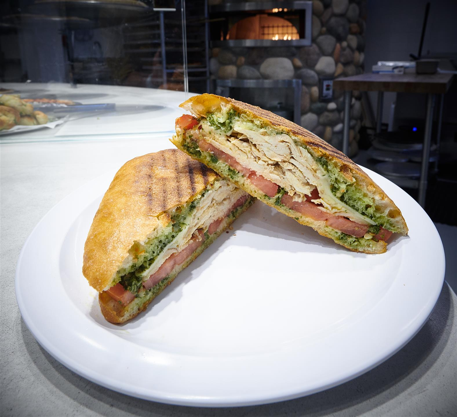 open faced chicken panini on a plate