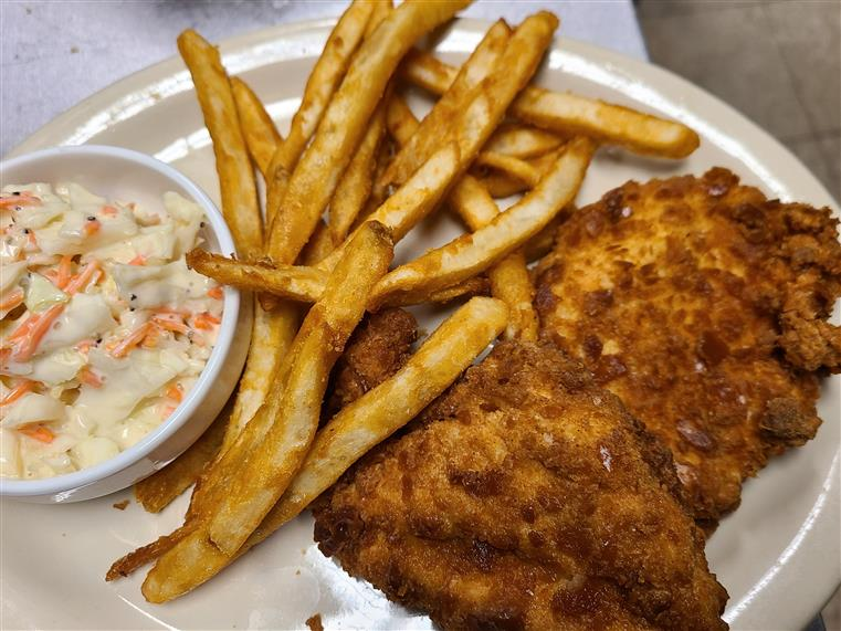 fried chicken with french fries and a side of coleslaw