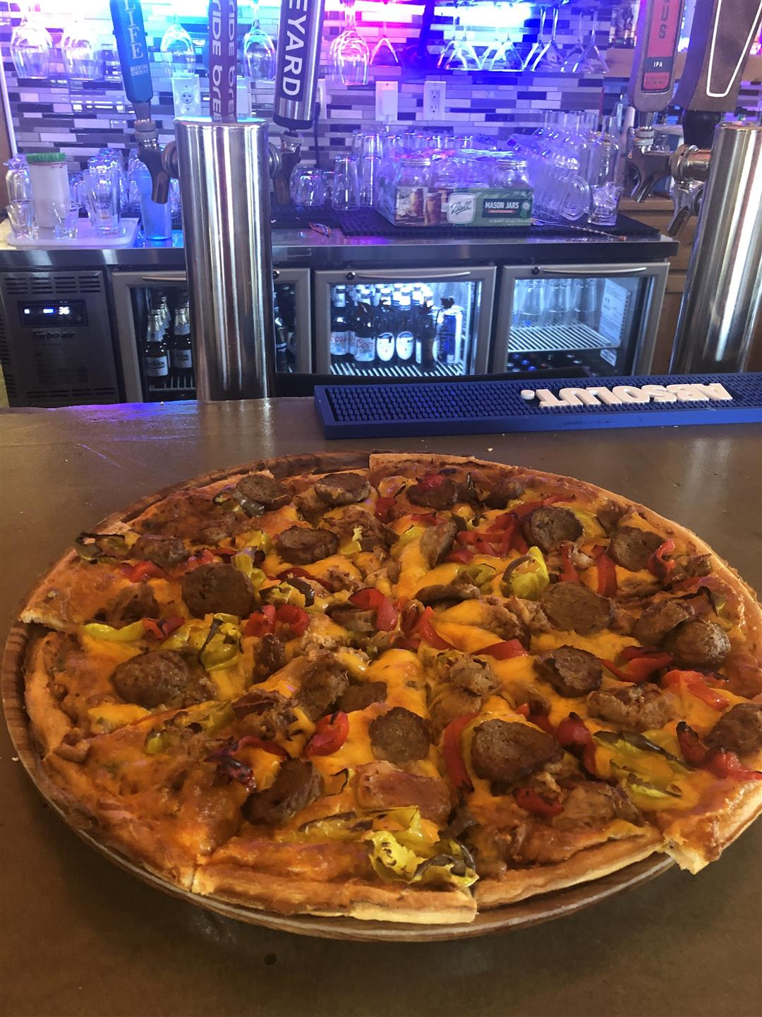 Pizza pie on bar counter